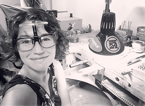 Ivy Klarer, jeweler at her workbench