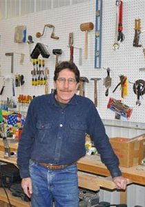 Tom Laudin, woodworker, in his shop