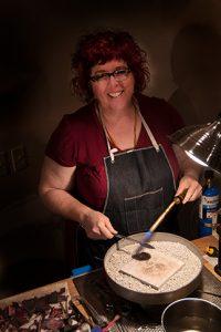Artist, Julie Raasch at work in her studio