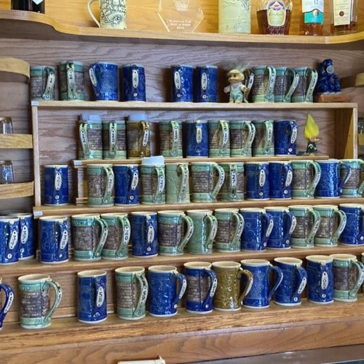 Mikel Kelley's mugs on display at Grumpy Troll